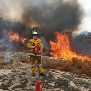 Tash on a controlled burn as a new volunteer of her local rural fire brigade. Photo supplied by Tash.