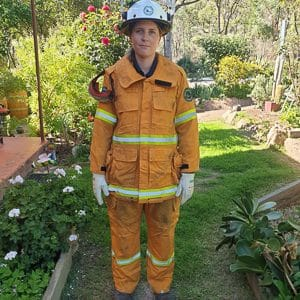 Freshly minted as a member of the Ballandean RFB, Tash wears her full firefighting uniform. Photo supplied by Tash.